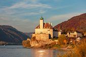 Small castle Schonbuhel above the Danube in the romantic sunset, Austria poster