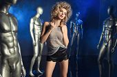 Sexy Blond Woman With Many Silver Mannequins poster