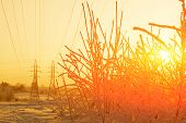 Sunset In Siberia. In Background Are High-voltage Supports. Orange. poster