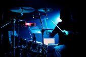 stock photo of drums  - Drummer playing drums in concert with silhouette and backlighting - JPG