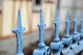 an old blue metal fence