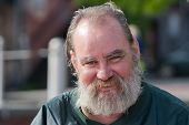 stock photo of hobo  - Homeless man with a smile on his face - JPG