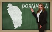 Teacher Showing Map Of Dominica On Blackboard