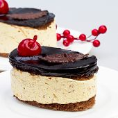 Dessert Tiramisu With Cream And Chocolate, More Beautiful Cherry.