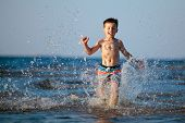 Cute little boy having fun at the beach