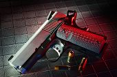 stock photo of handgun  - Steel semi automatic handgun with a red gel and textured background - JPG