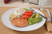 pic of high calorie foods  - A healthy diet dinner with grilled salmon avocado tomato and cottage cheese - JPG