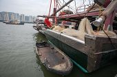Fishing vessel and a boat at the pier at the fishing port of Macau. China.