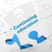 Education concept: Continuing Education on puzzle background