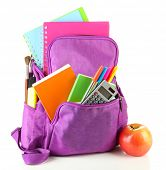 Purple backpack with school supplies isolated on white
