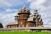 stock photo of reconstruction  - Antique wooden Church of Transfiguration at Kizhi island in Russia under reconstruction - JPG
