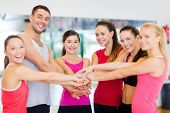 fitness, sport, training, gym, success and lifestyle concept - group of happy people in the gym cele