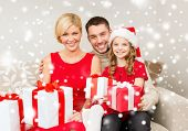 family, christmas, x-mas, winter, happiness and people concept - smiling family in santa helper hats