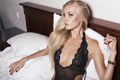 stock photo of silk lingerie  - beautiful sexy girl  with blond hair in lingerie - JPG