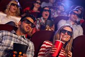 image of watching movie  - Young people sitting at cinema - JPG