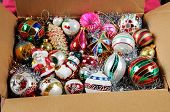 Christmas ornaments in cardboard box.