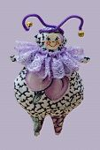 Hand Made Soft Toy Doll Isolated On Purple Background