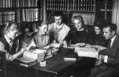 LODZ, POLAND - CIRCA FORTIES: Vintage photo of group of students working in library, Lodz, Poland, c