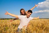 Teen couple on the wheat field