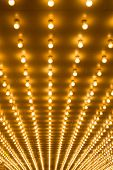 stock photo of marquee  - golden bulbs marquee lights background - JPG