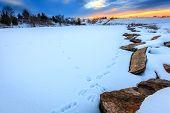 Sunset scene on a frozen lake