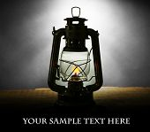 image of kerosene lamp  - Kerosene lamp on dark grey background - JPG