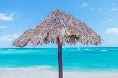 Wooden umbrella on the beautiful  punta cana beach