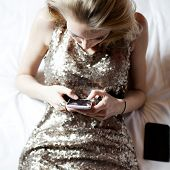 Blonde Young Girl With Cellphone.