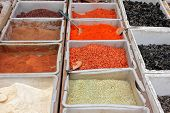Colorful spices displayed in an informal market, China