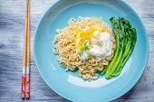stock photo of egg noodles  - Chinese Rice Noodle with fried egg on table - JPG