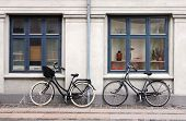 stock photo of scandinavian  - Two old fashioned bicycles leaning against a wall at Scandinavian street.