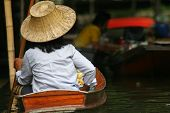 Local people in Thailand living and trading on the river - Damnoen Saduak floating market near Bangkok