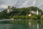 Bled cityscape, including Bled Castle on a precipice at left.