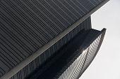 Curved sunlit facade of Hong Kong skyscraper