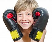 Young blond boy with boxing gloves