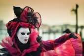 VENICE, ITALY - FEBRUARY 27, 2014: Unidentified person with Venetian Carnival mask in Venice, Italy