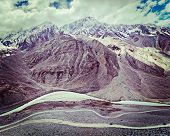 Vintage retro effect filtered hipster style travel image of Spiti valley, river, road in Himalayas. Himachal Pradesh, India