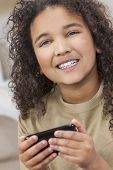 Beautiful young mixed race interracial African American girl child smiling with perfect white teeth