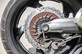 Close Up Of A Motorcycle's Front Wheel And Brake Disc