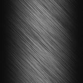 Metal background or texture of dark brushed metal plate