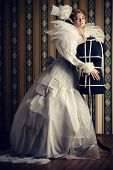 stock photo of dress mannequin  - Beautiful fashion model in the refined white dress and mannequin - JPG