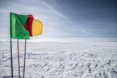 Flags on the background of winter sky