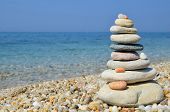 stock photo of orientation  - Stack of multicolored zen stones on a pebble beach Greece horizontal orientation - JPG