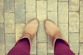 foto of platform shoes  - Brown shoes from aerial view on concrete block pavement - JPG