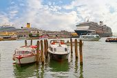 Venice, Italy - 4 September, 2014: The cruise ship crosses the Venetian Lagoon. Venice is the most popular tourist destination in Italy.