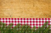 A rustic wooden background with fir green