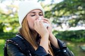 Portrait Of Beautiful Girl With Tissue Having Flu Or Allergy.