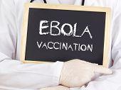 Doctor Shows Information: Ebola Vaccination