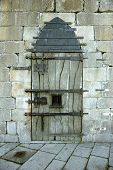 pic of slave-house  - Very old castle door with rusty details - JPG