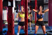 Gym women with barbell and kettlebell workout exercise